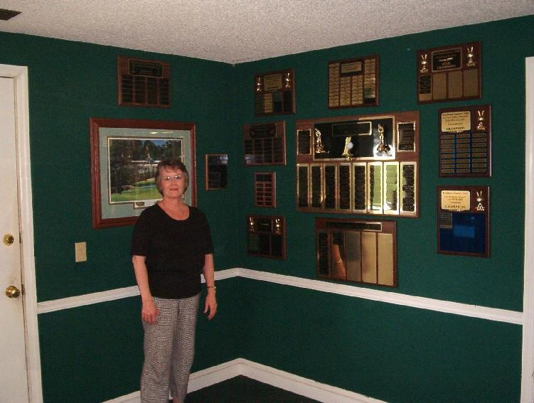 Elaine showing off our trophy wall